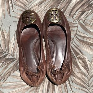 Tory Burch brown leather flats with gold emblem